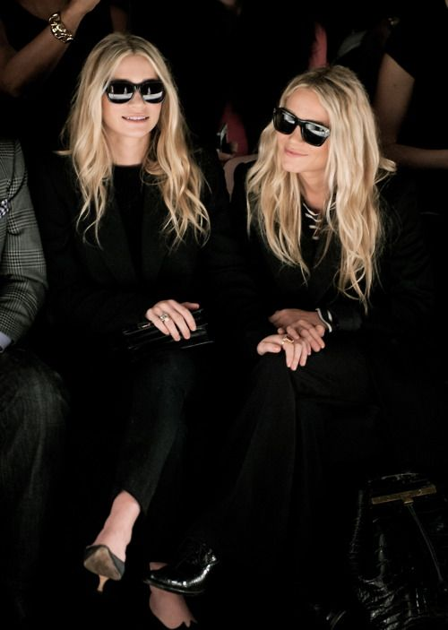 Mary-Kate and Ashley donned all-black suits with retro shades.