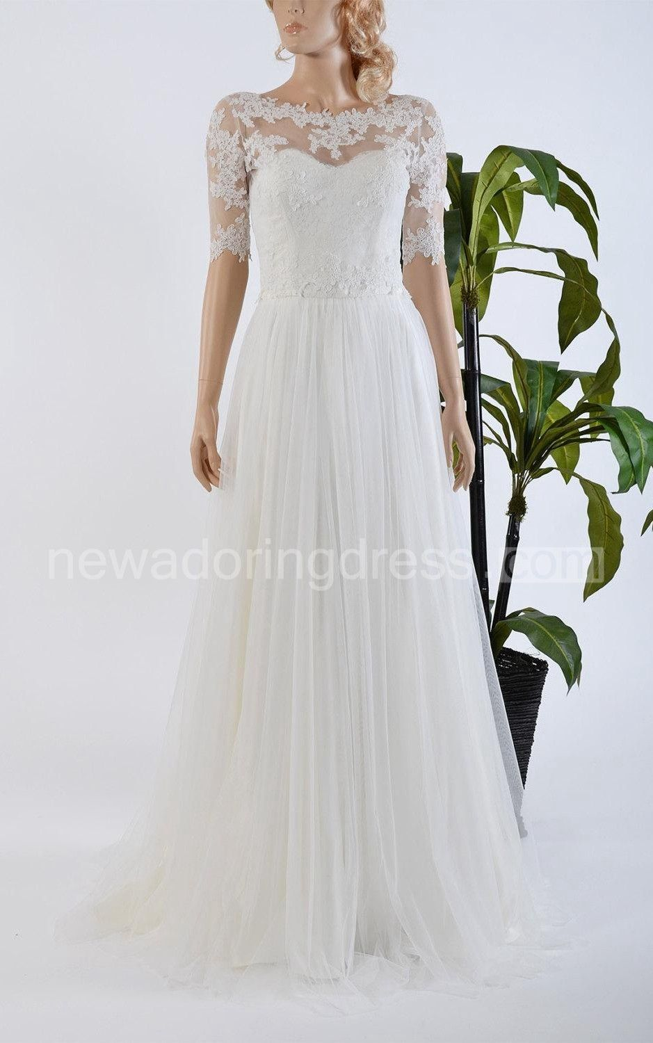 Jewel neck long aline wedding dress with lace bolero on tulle