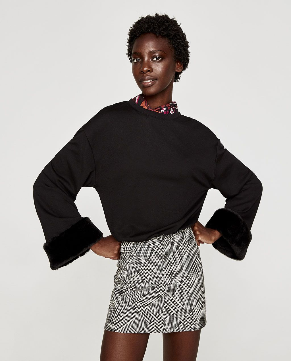 Image of sweatshirt with sleeve appliquÉs from zara winter style