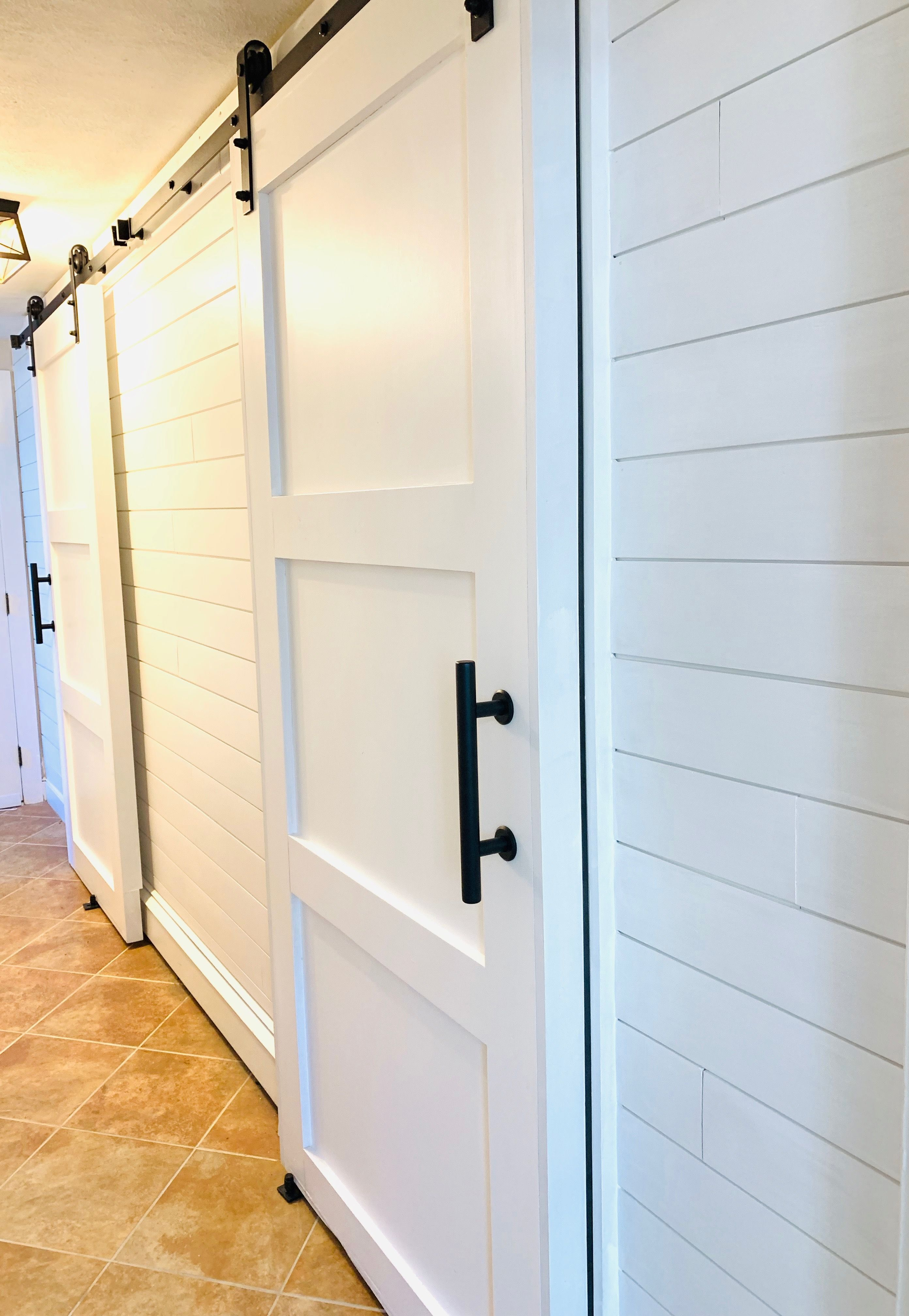 Beautiful Modern Farmhouse Barn Doors Hung Over Baseboard Heating Check Out The Tutorial Modern Farmhouse Diy Modern Barn Door Barn Door