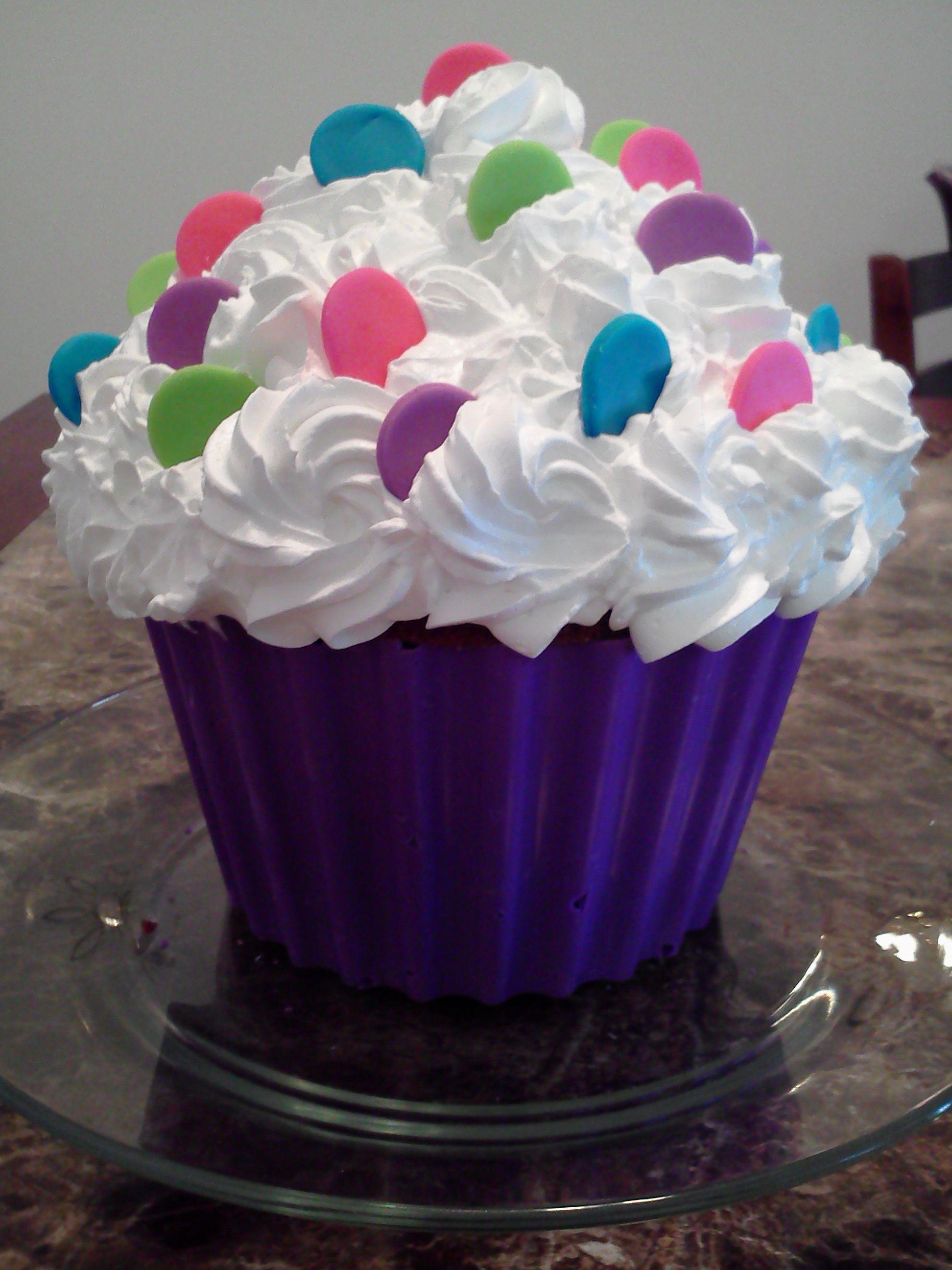 Giant cupcake cake strawberry cake with whip cream icing