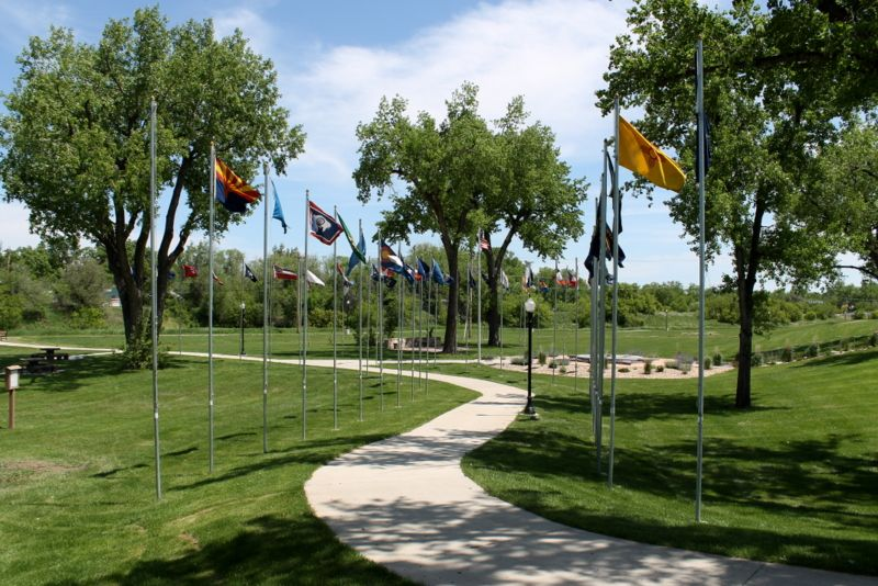 Take the Flag Walk to the Center of the Nation! Featuring flags from all 50 states, and Canada