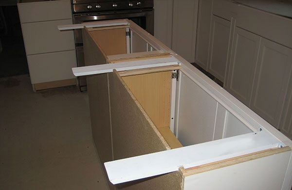 Countertop supports for islands are hidden and simple to for Granite overhang without support