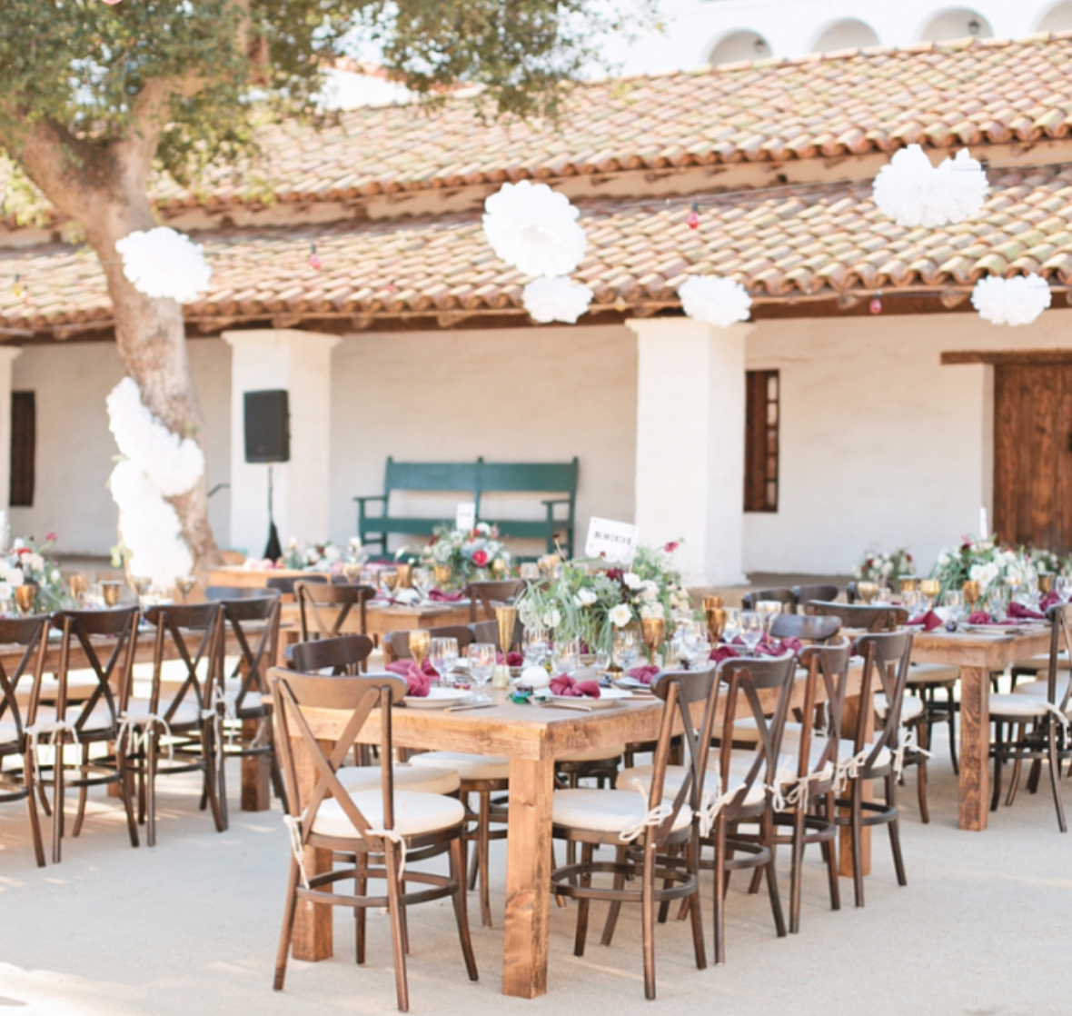 White hanging pom poms over open air tables at this tuscan themed white hanging pom poms over open air tables at this tuscan themed outdoor wedding junglespirit Image collections