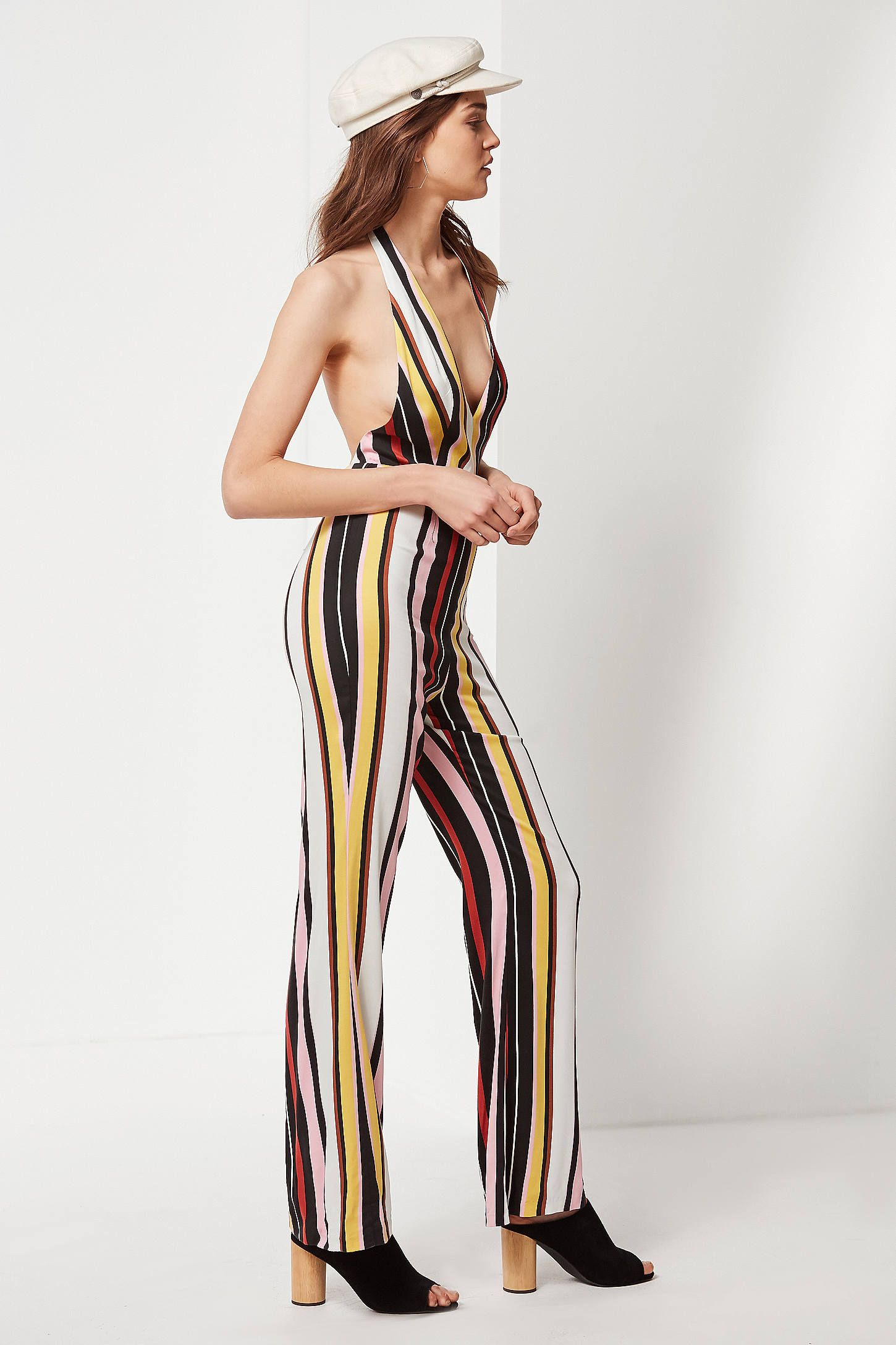 603929c7b7f Shop UO Shiloh Plunging Flare Jumpsuit at Urban Outfitters today. We carry  all the latest styles