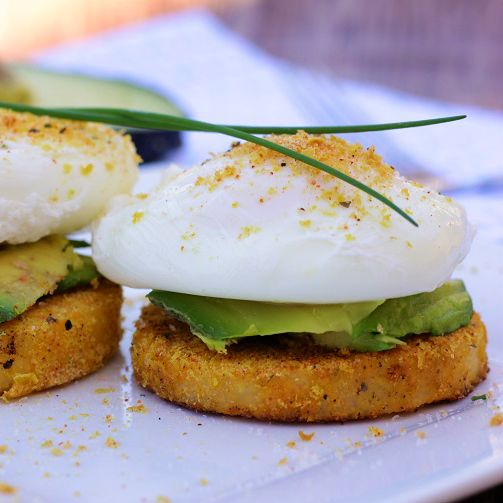 Polenta Eggs Benedict- prepared tubed polenta, nutritional yeast, Mrs. Dash garlic seasoning, avocado, 2 eggs