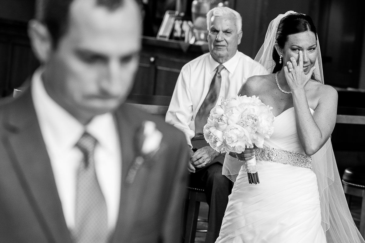 An emotional moment during the bride & groom's first look at Eaglewood Resort.