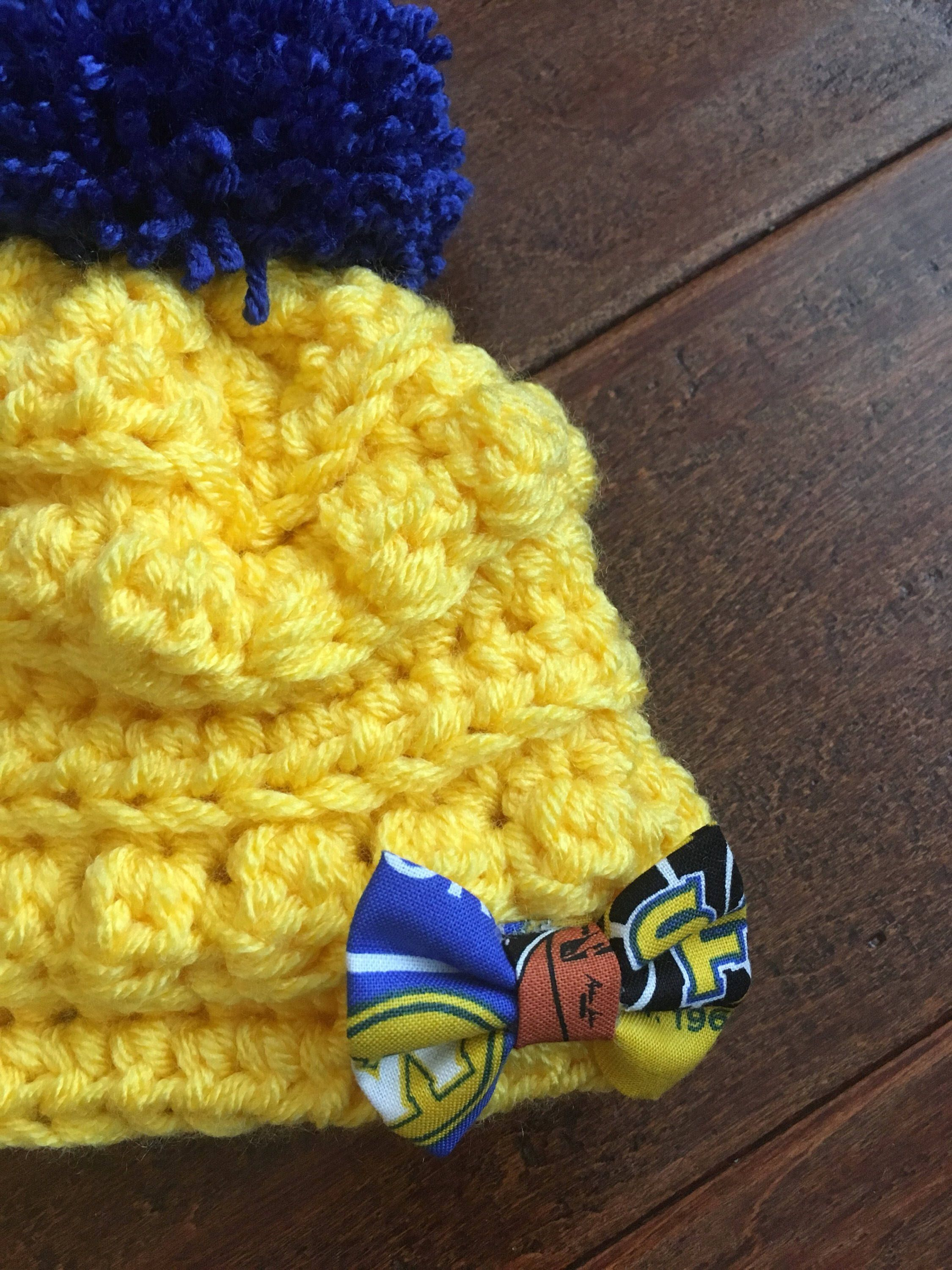 4ef6d5f43d7264 Golden state warriors Crocheted baby beanie with pom pom. Yellow hat with blue  pom pom and Warriors bow. Winter baby hat. Perfect gift for her.