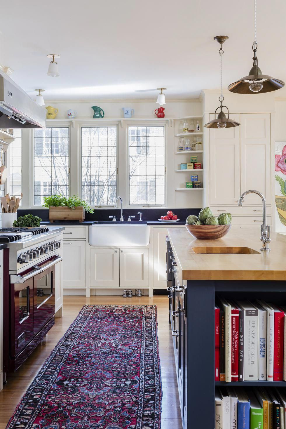 in this boho kitchen open shelving topped with cheerful ceramics pairs well with navy paint on kitchen interior boho id=92942