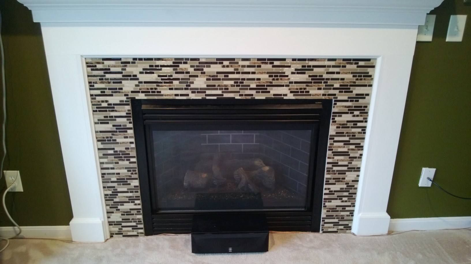 Diy Tile Fireplace Makeover With Peel And Stick Tiles Diy Fireplace Makeover Fireplace Tile Fireplace Makeover