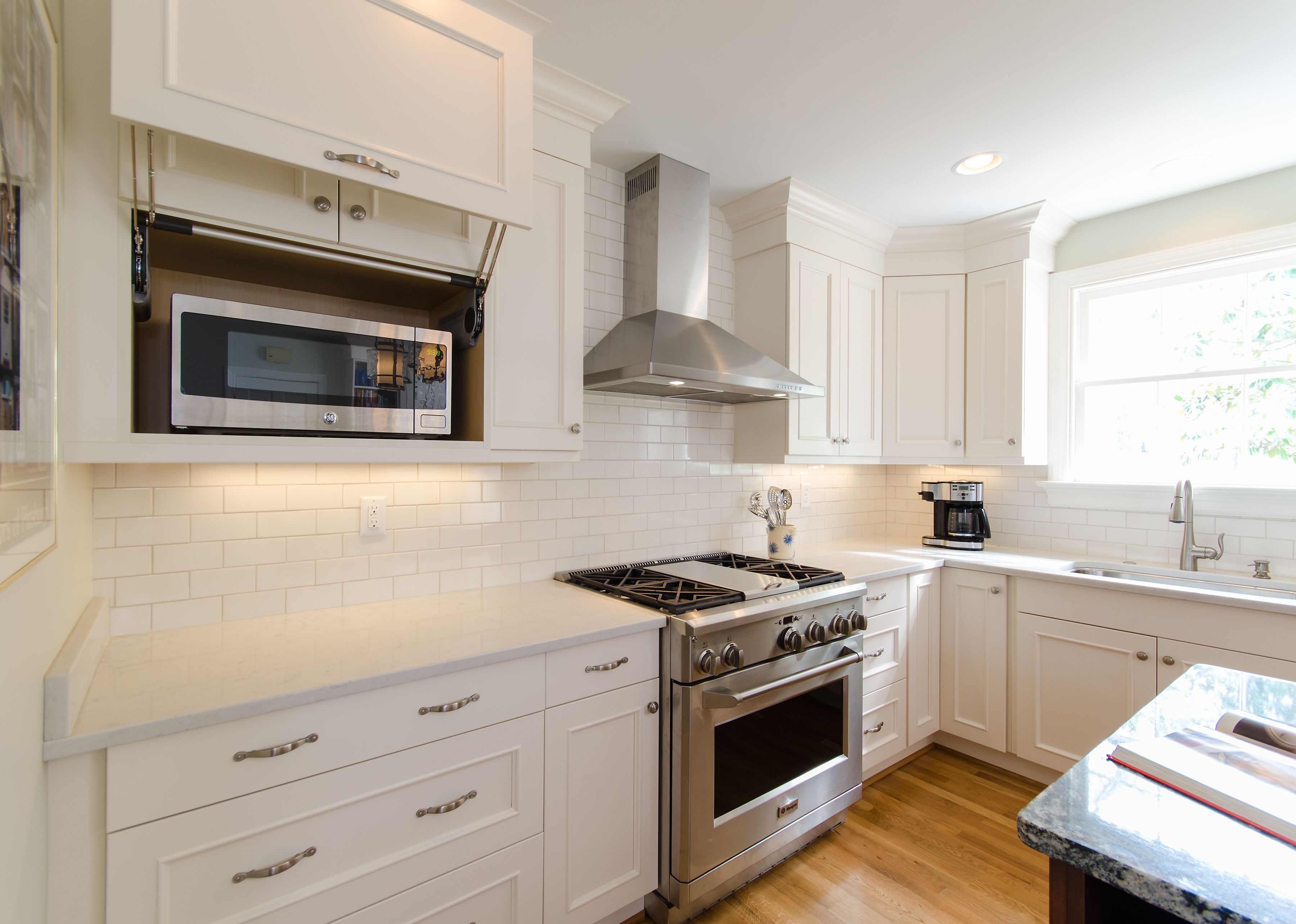 Microwave Neatly Hidden Away In A Customized Cabinet By Elmwood.