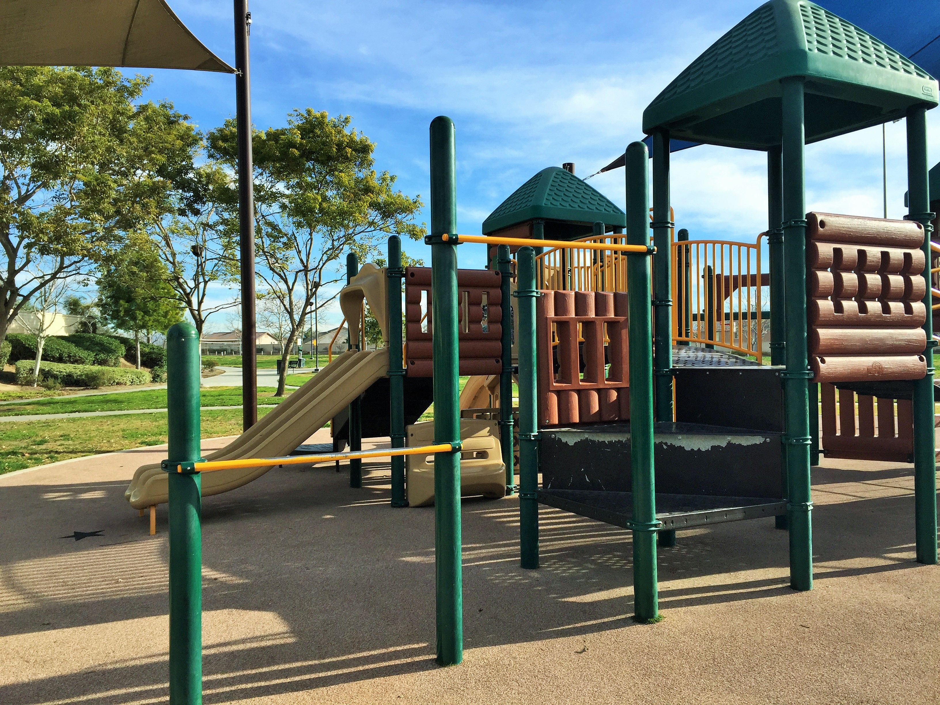 Two gymnastics bars on the playground for little kids at