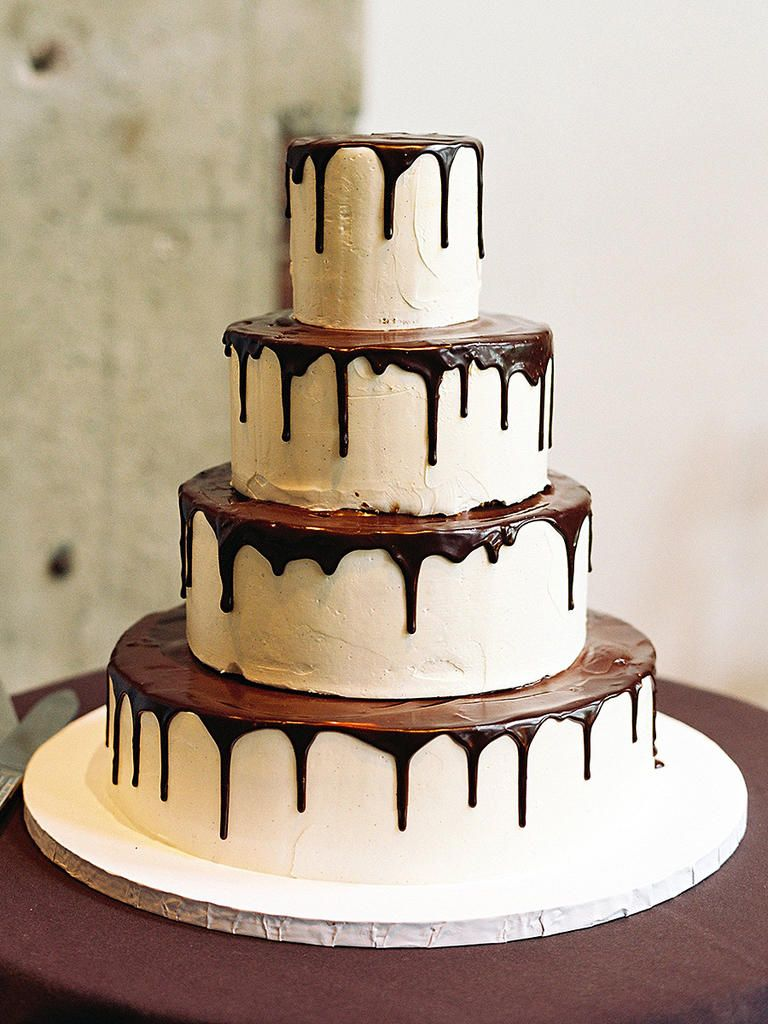 Let your wedding cake speak for itself with a simple chocolate drizzle design dripped loosely down sweet stacked tiers.