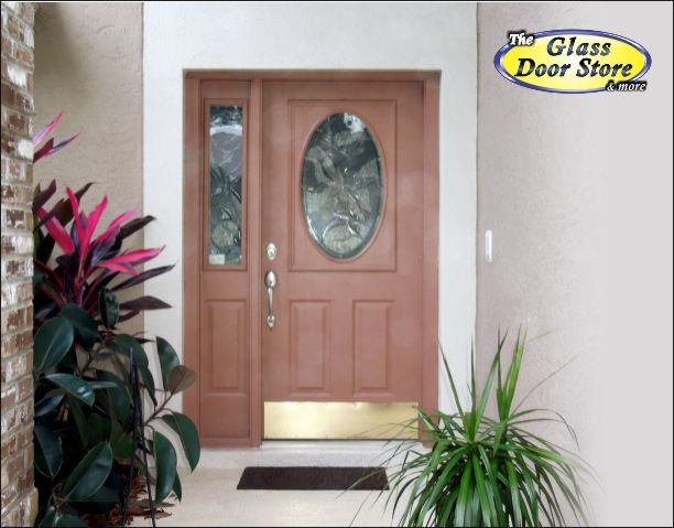 Oval Glass Insert With Matching Sidelight In The Front Entry Door
