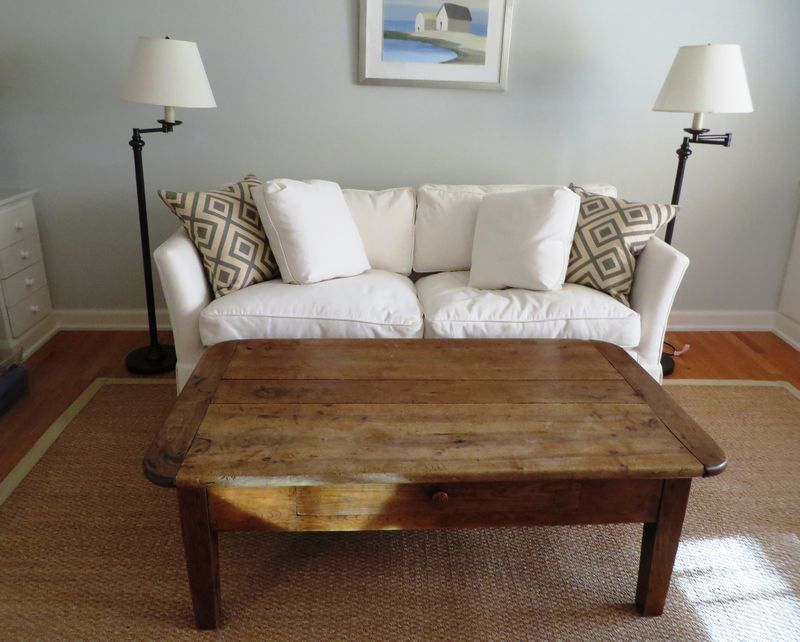 Carlyle Sleeper Sofa Bed Upholstered In White Cotton Duck Antique French Farm Walnut Coffee Table