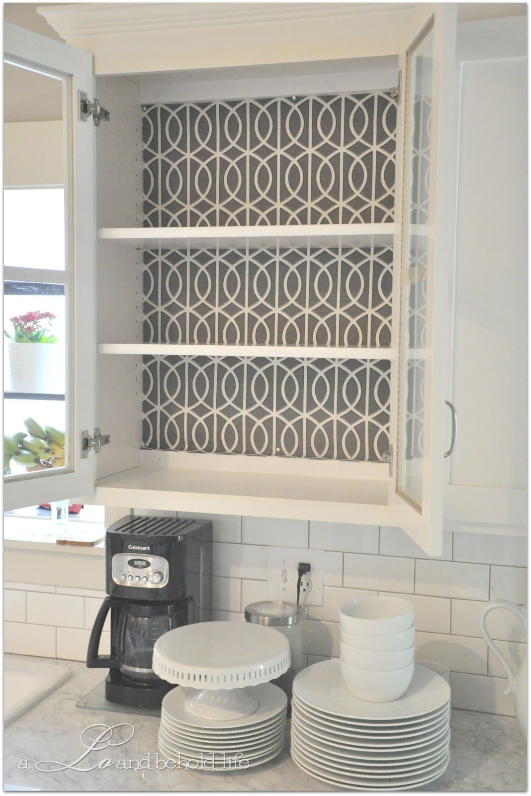 Use Fabric For The Backing Of Shelves Instead Of Paint Or Wallpaper Love This Idea For Glass Front Cabinet Glass Front Cabinets Kitchen Renovation Diy Kitchen