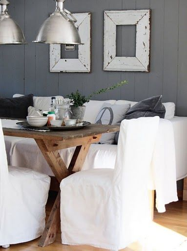 Love the grey with white....the slipcovered couch with the dining table.  Very cottage