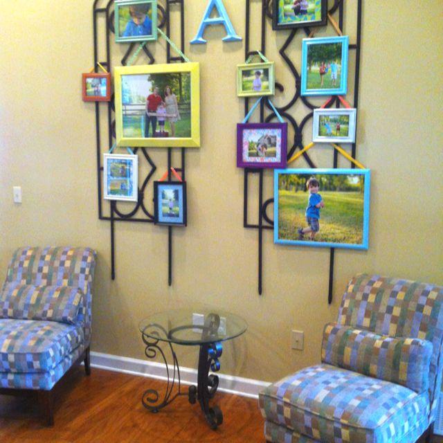 Family picture wall display with colorful frames and wrought iron ...