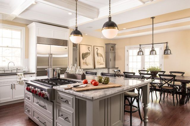 Color your open concept kitchen with Dovetail Gray (SW 7018) cabinets and Believable Buff (SW 6120) walls.