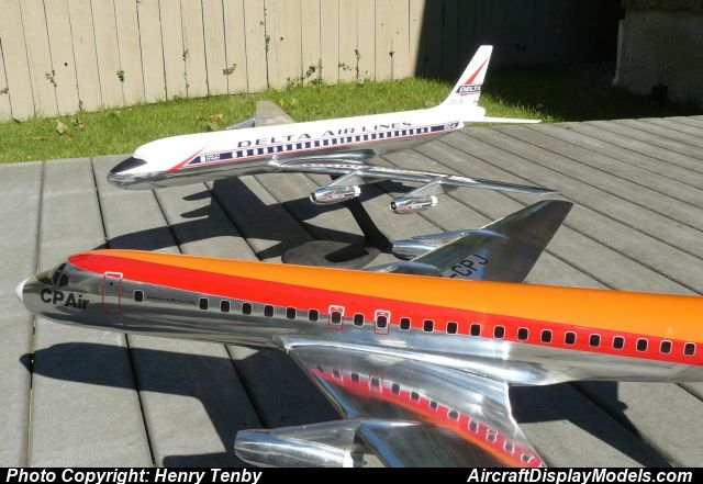 Two large metal recast 1 50 DC-8s CP Air and Delta birds - how would you weigh a plane without scales