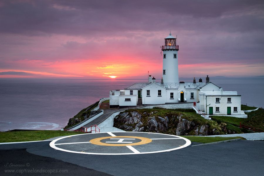 Sunrise at Fanad Lighthouse , Co Donegal , Ireland.  The second-most northern point in Donegal, Fanad Head thrusts out into the Atlantic to the west of Rosguill. The peninsula curls around the watery expanses of Mulroy Bay to the west, and Lough Swilly to the east.