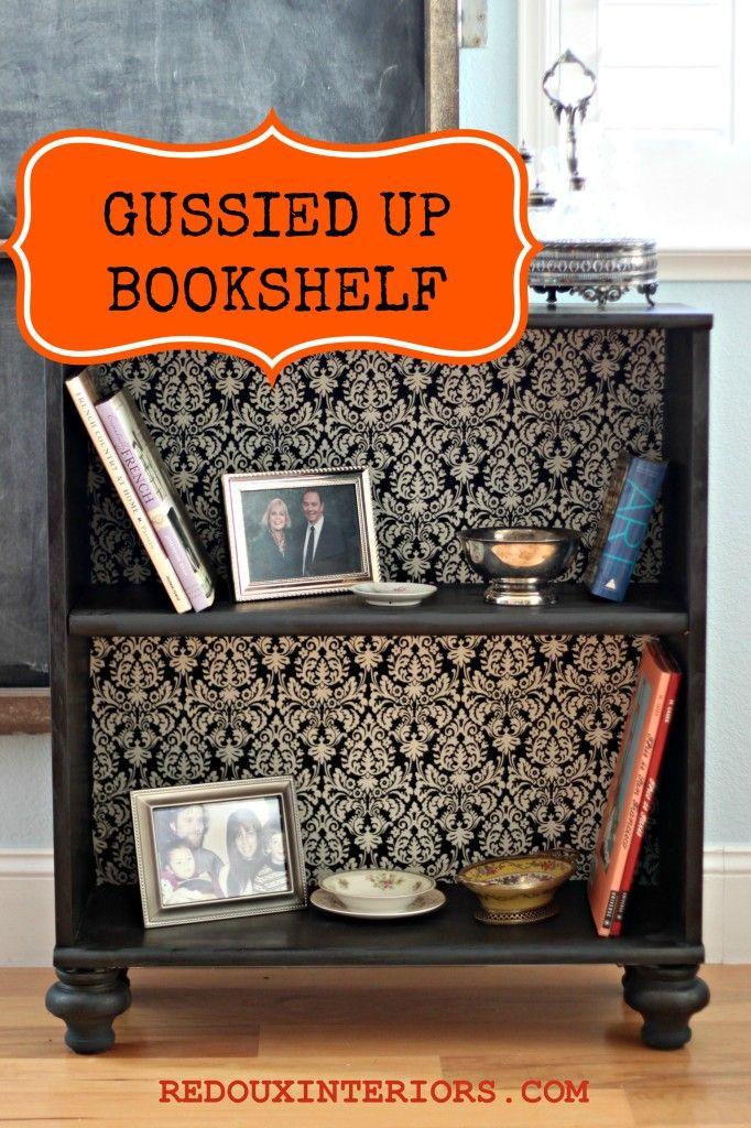 Wallpaper, paint, scrapbook paper, or beadboard the back of a cheap bookshelf, add feet, plus pretty wood trim, and voilá!