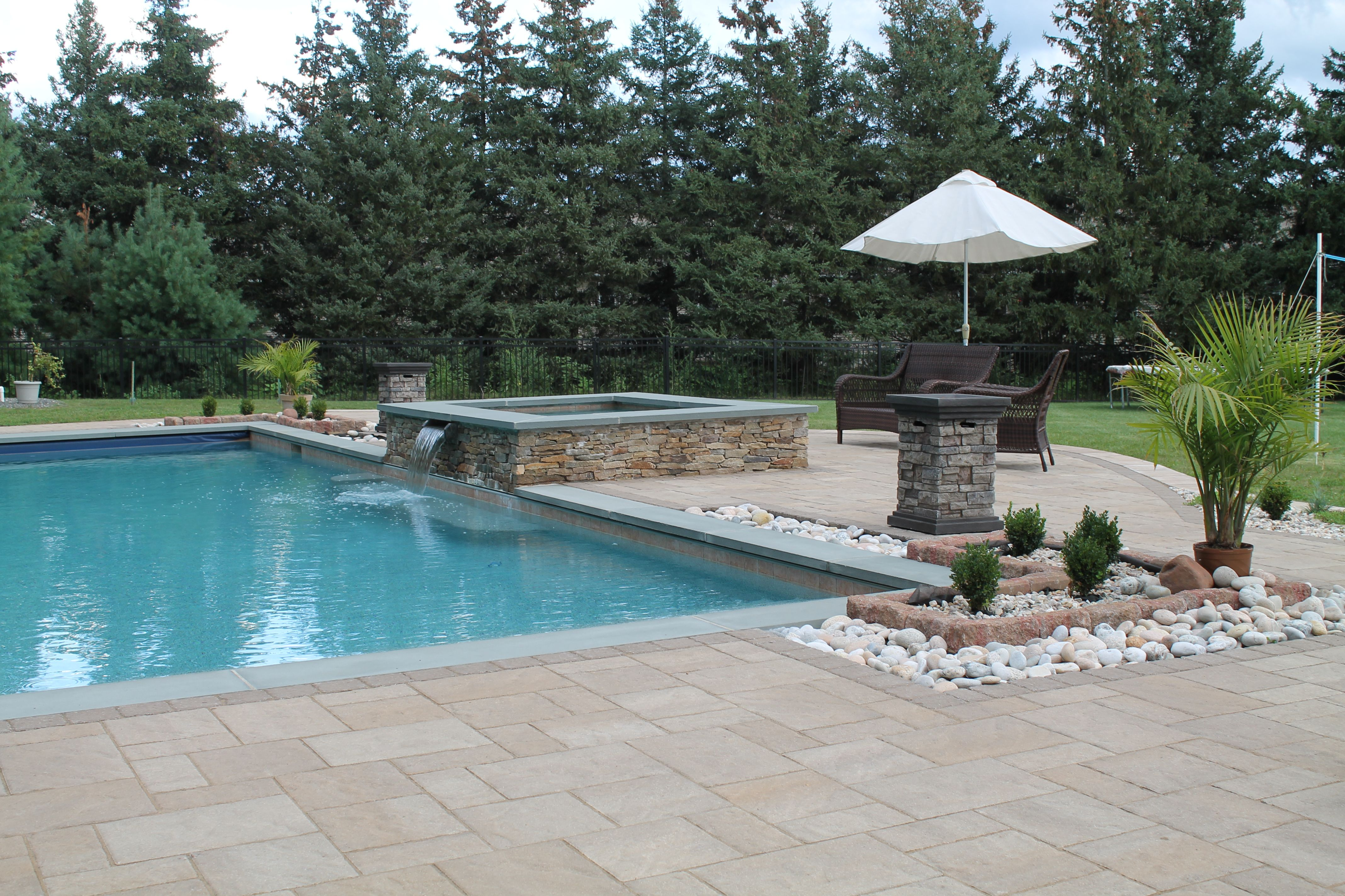 Concrete paver pool patio by Bahler Brothers with landscaping, fire ...