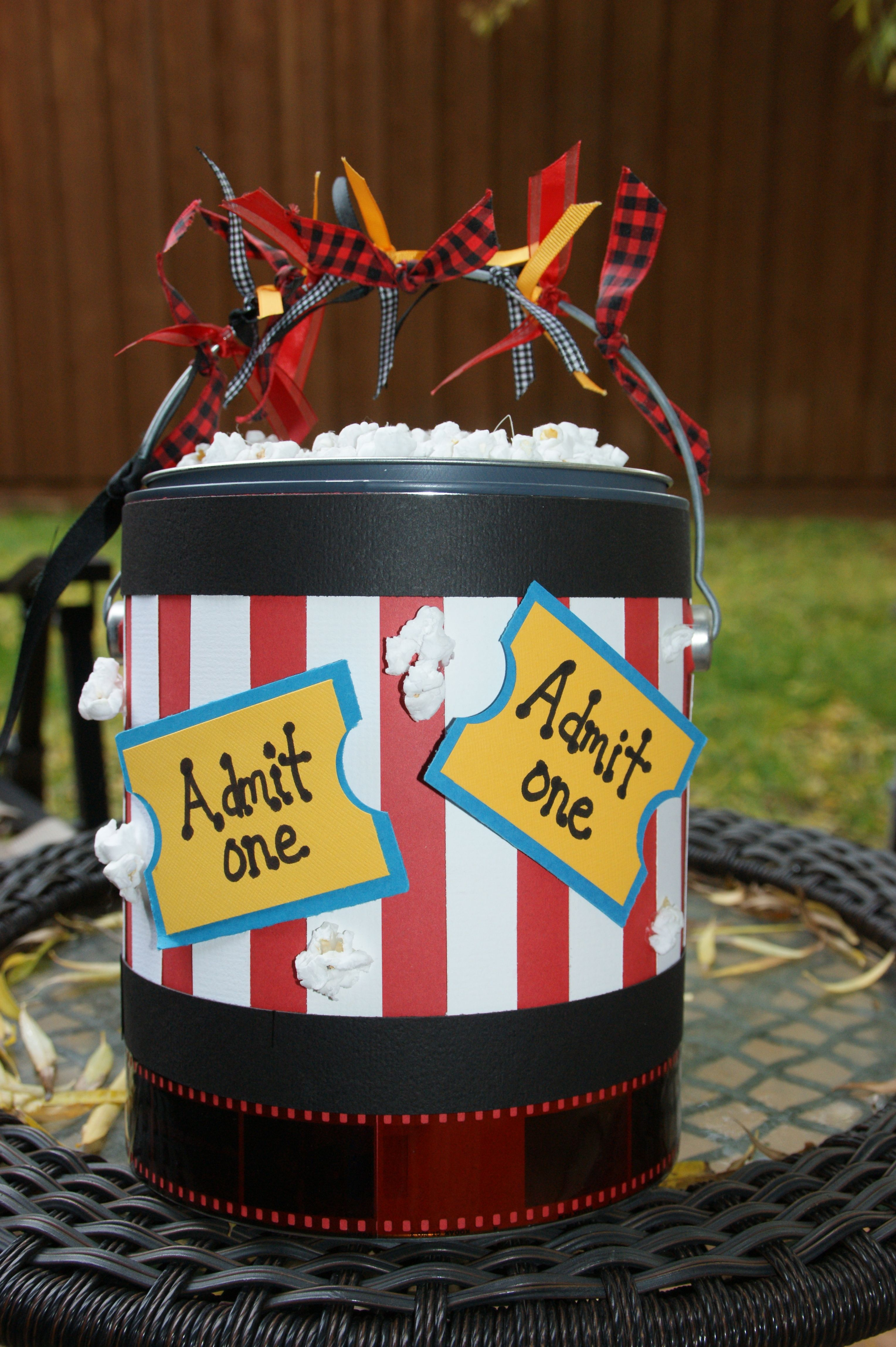Movie time Paint can...a little candy, some microwave popcorn, and a DVD or gift certificate and you have a great gift :)  Real popcorn on top, sprayed with a sealer.