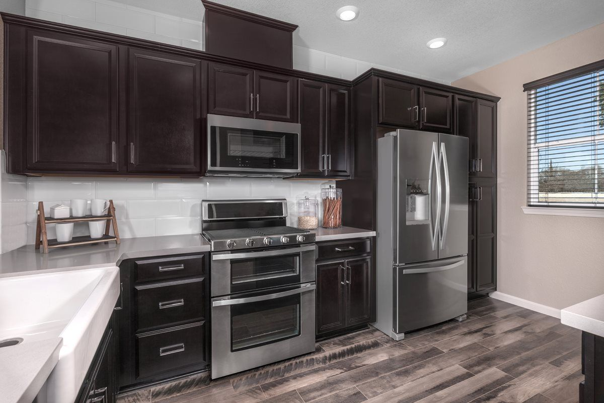 Not Only Are Cabinets Used For Storage But They Can Act As A Focal Point In Your Kitchen Like These Dark Espr Kb Homes New Kitchen Cabinets Espresso Cabinets