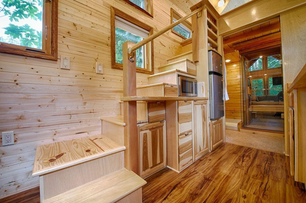 Tiny House Staircase Integrated Into The Kitchen. Bathroom In The  Background Has A Sauna And