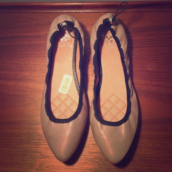 Brand new Vince Camuto Tan Ballet Flats-8.5 Supple tan leather with black ribbon ridge. Vince Camuto Shoes Flats & Loafers