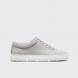 Low top cow leather sneaker in komodo ice pearl. Tonal leather trim and lace-up closure and a white rubber cup sole unit. Full calf leather lining and insole. Come in a branded box with a dust bag and a spare set of waxed laces.