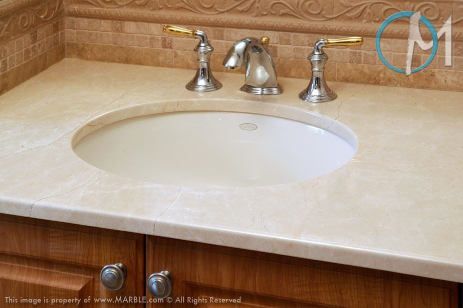 Charming The Smooth Simple Pattern Of Crema Marfil Is Accompanied By Polished Metal  Plumbing Fixtures With Gold