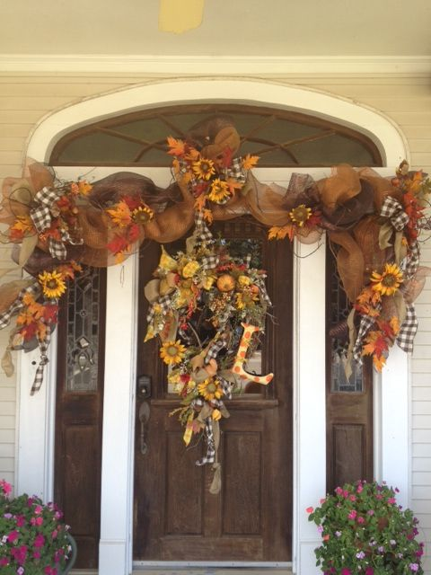 A Beautiful Fall Doorway Featuring A Wreath And Mesh