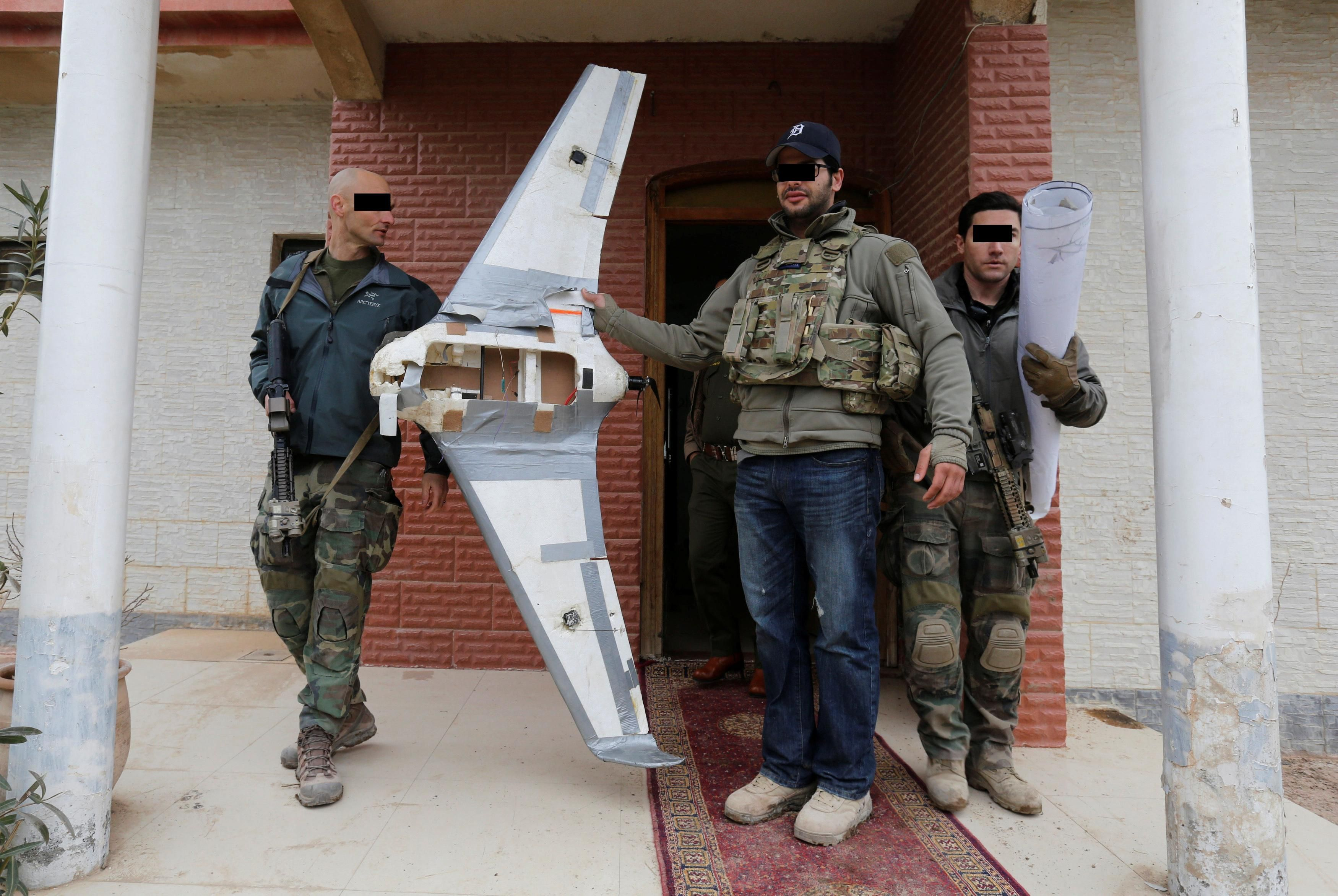 Marine Raiders With A Captured Daesh Drone Uav And A Blueprint Used To Drop Explosives On Iraqi Forces In Mosul Iraq 35002343 Marine Raiders Iraq Drone