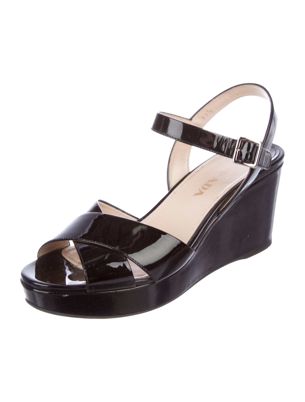 Black patent leather Prada wedge