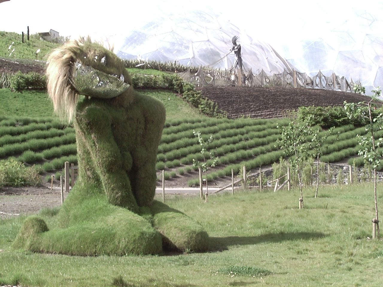 Lawn sculpture of a woman framed against the eden project biomes lawn sculpture of a woman framed against the eden project biomes publicscrutiny Image collections