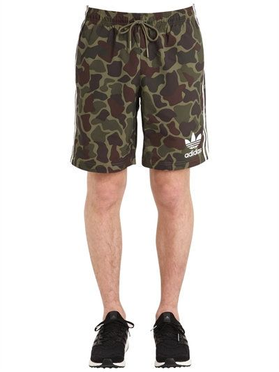 ADIDAS ORIGINALS CAMO PRINTED SWIM SHORTS, GREEN CAMO. #adidasoriginals  #cloth #swimwear