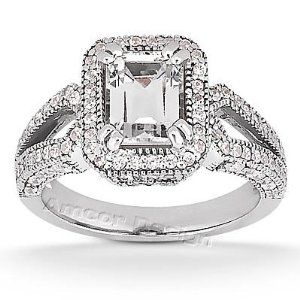This Emerald Cut Engagement Ring Features A Plethora Of Sparkling Round Diamonds On The White Gold Band Center Diamond Is