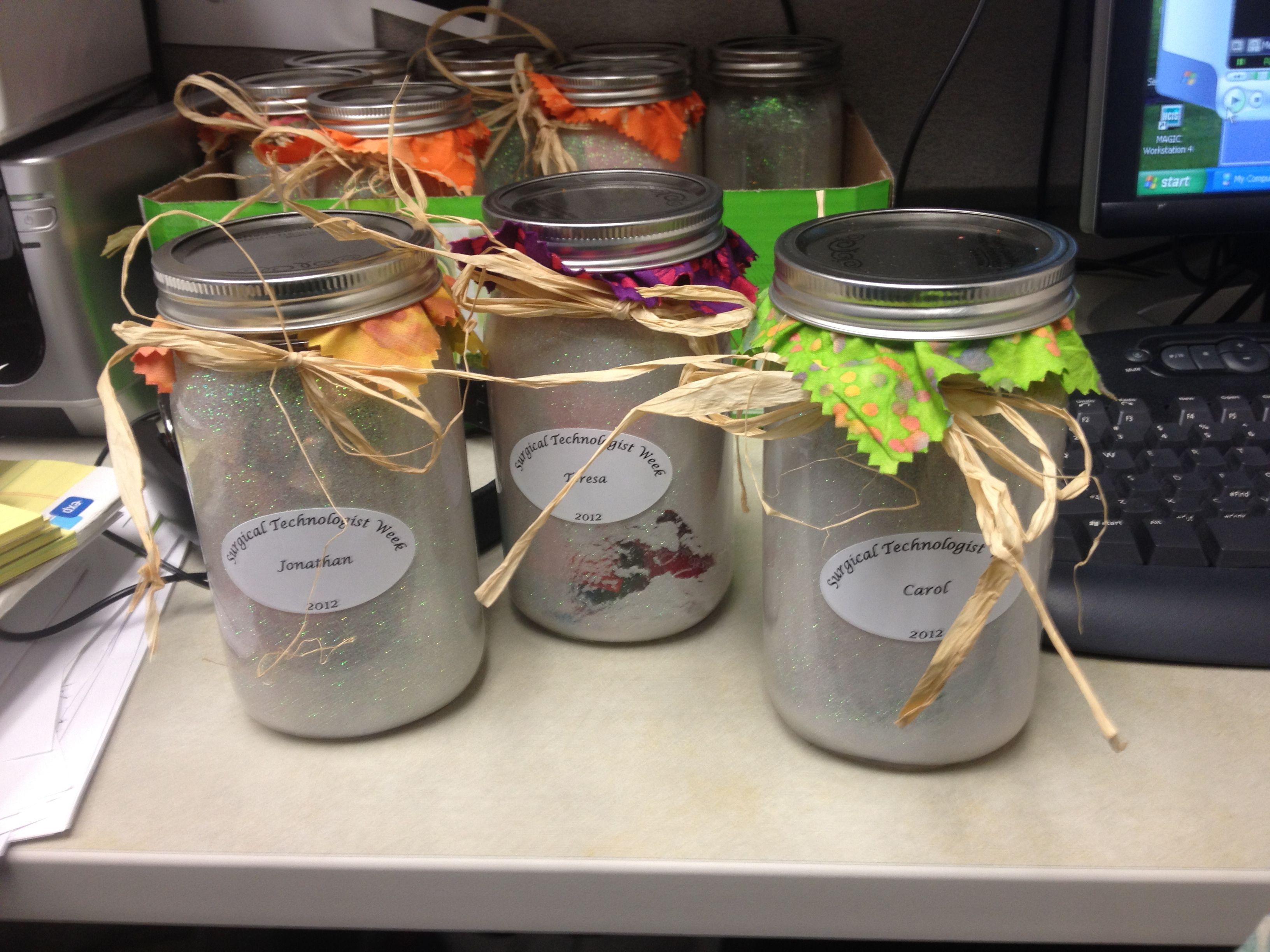 Mason jars frosted with Mod Podge and extra fine glitter
