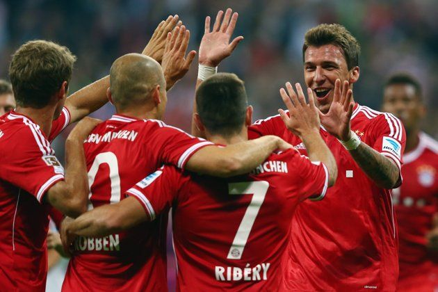 MUNICH, GERMANY - AUGUST 09: Mario Mandzukic of Muenchen celebrates his team's second goal with team mates Franck Ribery, Arjen Robben and Thomas Mueller (R-L) during the Bundesliga match between Bayern Muenchen and Borussia Moenchengladbach at Allianz Arena on August 9, 2013 in Munich, Germany.