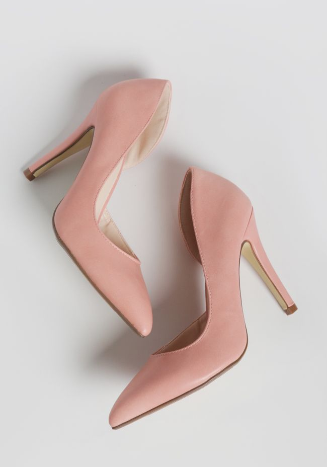 Chic and polished, these stunning pink faux leather heels are designed with pointed toes and sleek d'orsay cutouts at the side.