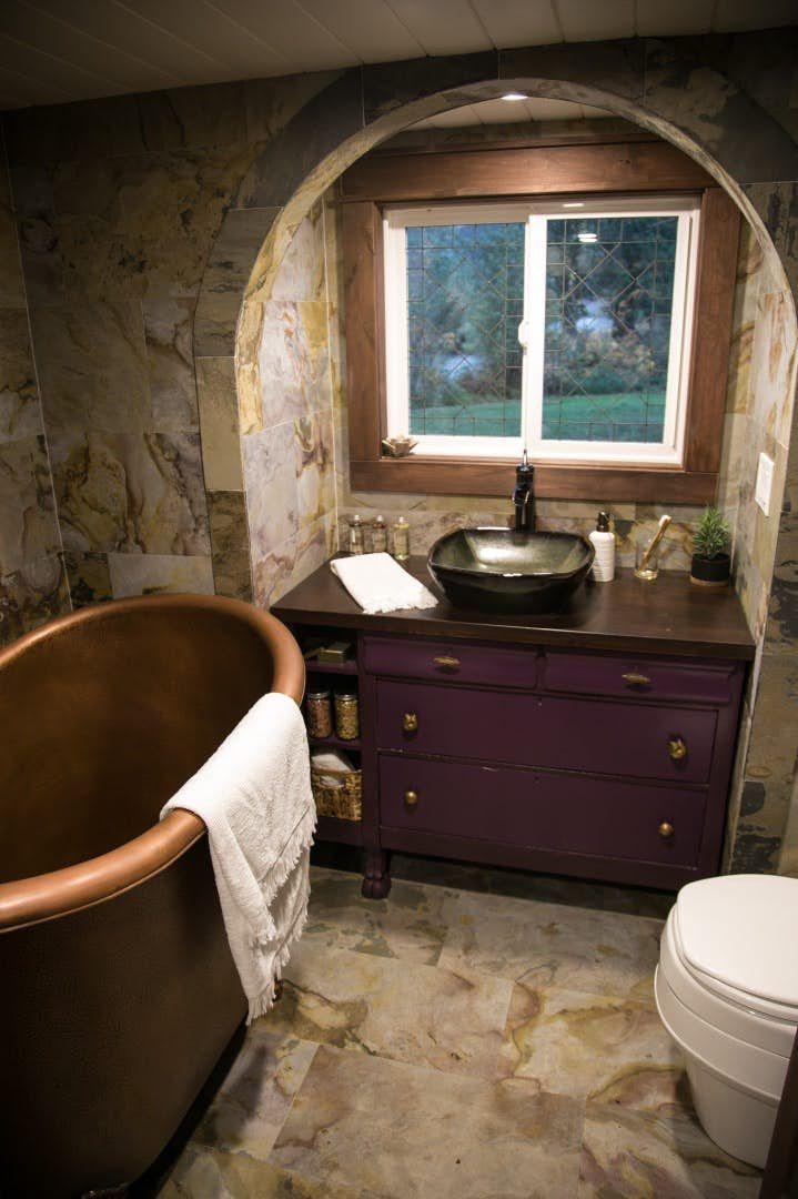Whimsical tiny house features distinctive Tudor styling #tinyhousebathroom