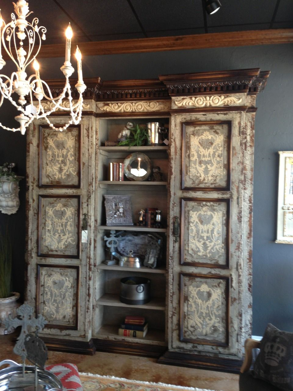 Toluse bookcase. Old world grey distressed, bone scrolls, mahogany trims and molding. Made with reclaimed woods in Peru and distributed to the world from Houston, TX. Explore more at...