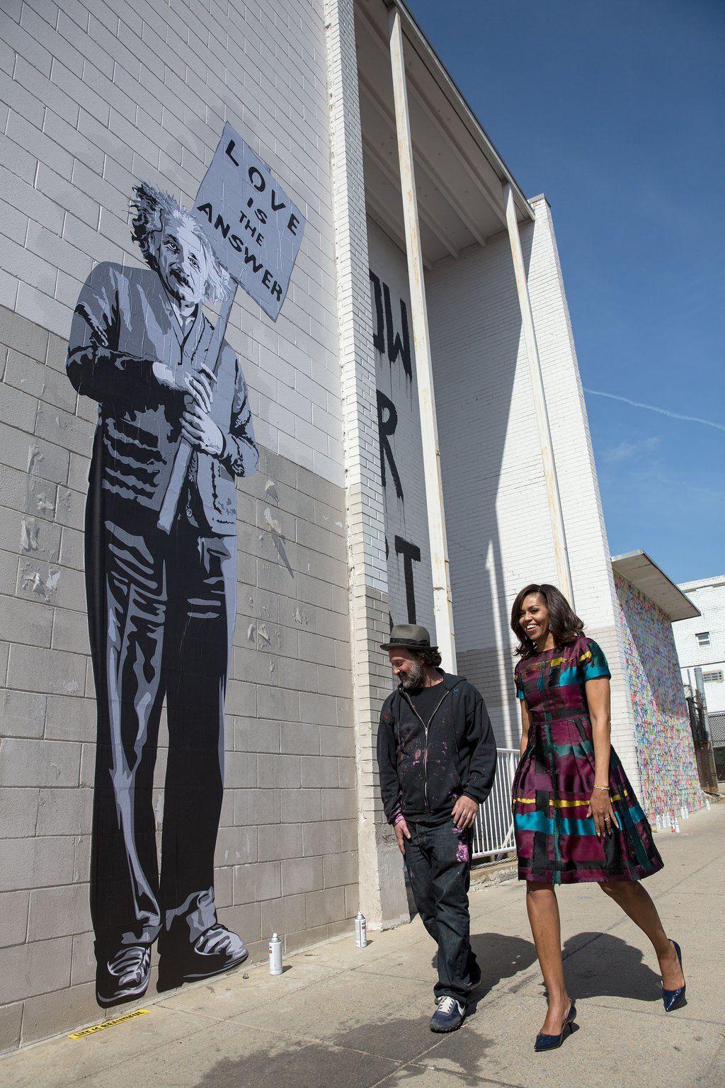 @AlbertEinstein : An oldie but goodie. Here's @FLOTUS and @MrBrainwash standing next to an Albert Einstein mural. http://bit.ly/1VZ0Pa2