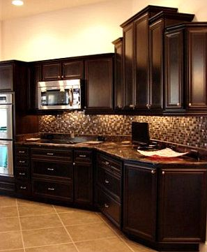 Cabinet Colors dark brown cabinets, light tile & paint, small glass tile
