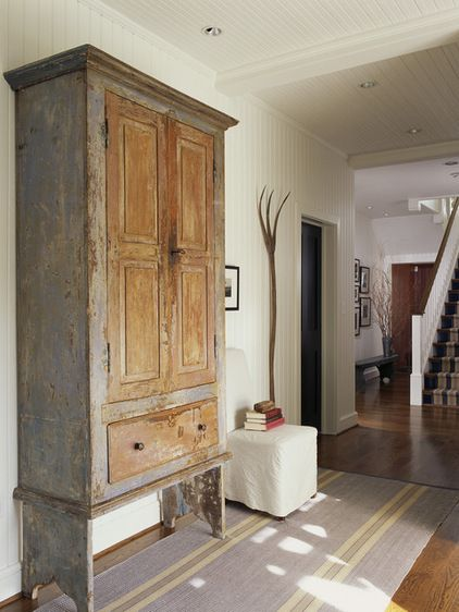 This Primitive Painted And Distressed Example Graces An Entry Hall, Where  It Offers A Multitude Of Storage Options. By Designer Patrick Sutton.