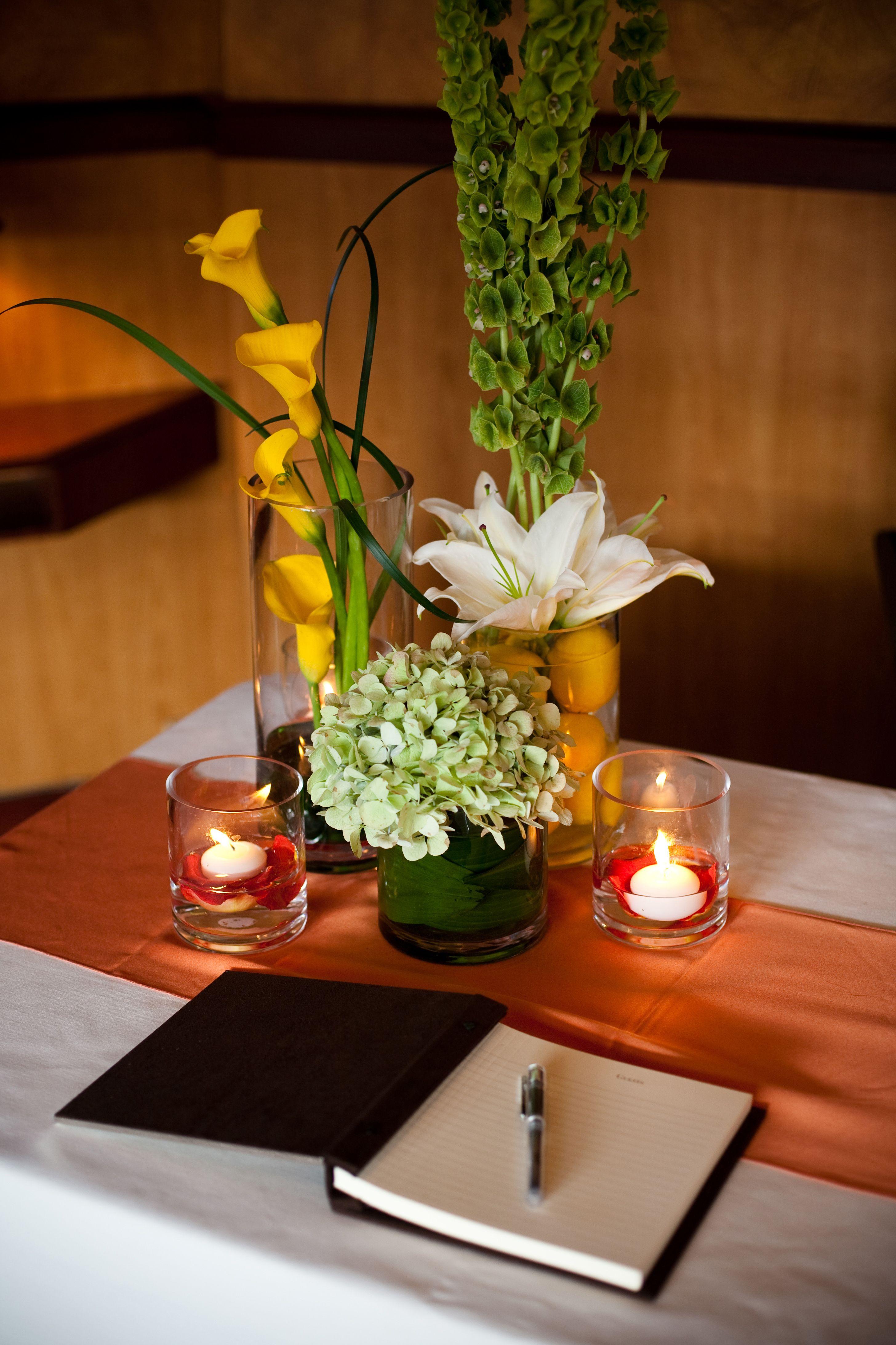 Burnt Orange Table Runner, Candles, And Varied Height Flower Arrangements  From J U0026 Cu0027s