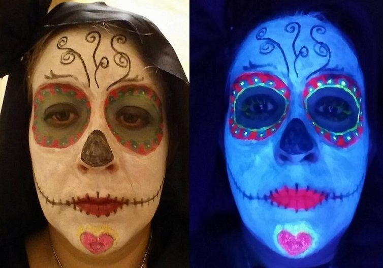 """Halloween 2015! All of this is from GloMania's body paint & make up selections (except the black eye liner pencil for the swirlies, my nose, & """"teeth""""). I love the new visible White body paint! It lasts forever; however, it does flake a little after it's dried out. Left is standard lighting, right is under a black light."""