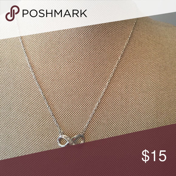 New in Box Sterling Silver Infinity Necklace New in box Sterling Silver Infinity Necklace With Crystal Stones. Markings 925 on back. Jewelry Necklaces
